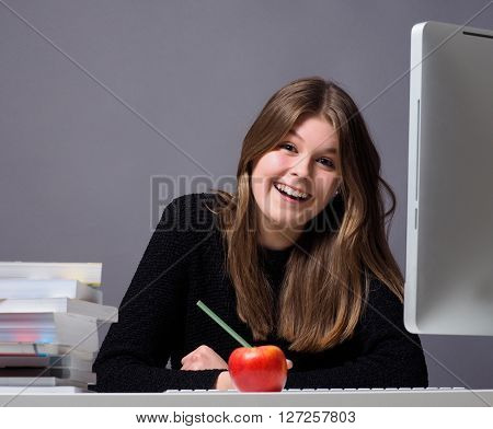 Young woman in an office working on a computer