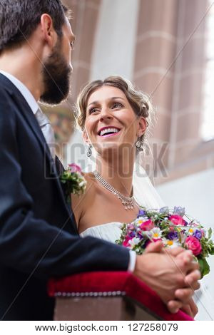 Couple of bride and groom having wedding in church