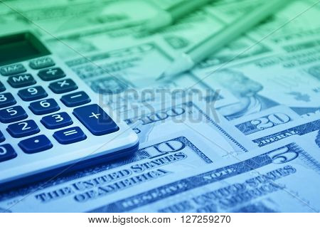 Calculator button plus and pencil on dollar bank note money Finance concept