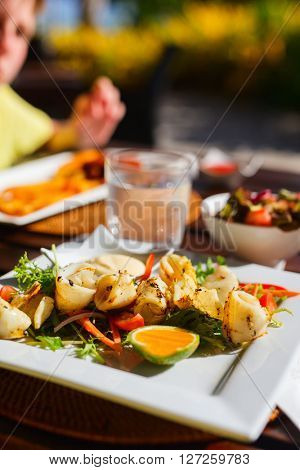 Delicious fried calamari served with vegetables for lunch
