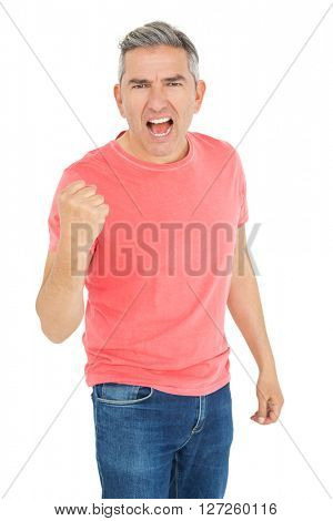 Excited man shouting with fist up on white background