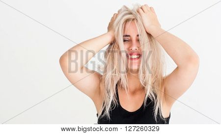 Amazement happy smiling girl with closed eyes on white background. Concept of success, winning, lottery, win, happiness, luck. Positive facial expression of young blonde woman with beautiful smile.