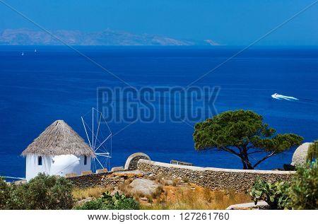 White greek windmill overlooking Mediterranean Sea on Mykonos Island, Greece, Europe