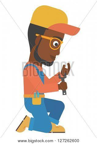 Repairman holding spanner.