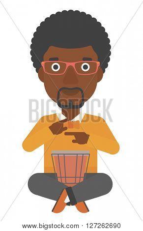 Man playing tomtom.