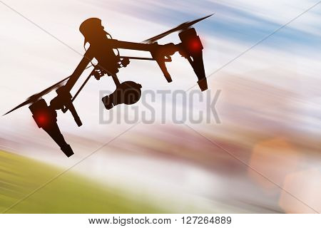 Drone with high resolution camera flying, close-up.