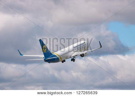 Borispol Ukraine - October 2 2010: Ukraine International Airlines Boeing 737 passenger plane is taking off into the cloudy sky