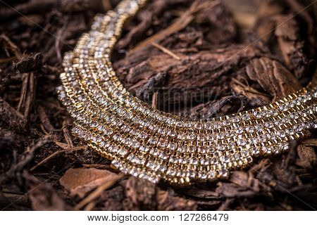 Goldplated feminine necklace with rhinestone, studio shot