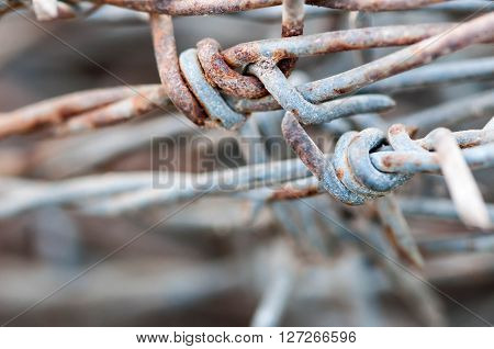 old rusty barbed wire in the country