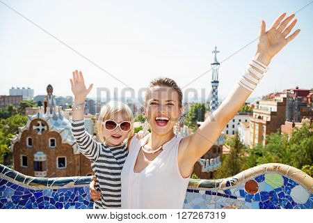 Happy Mother And Baby At Park Guell Rejoicing, Barcelona