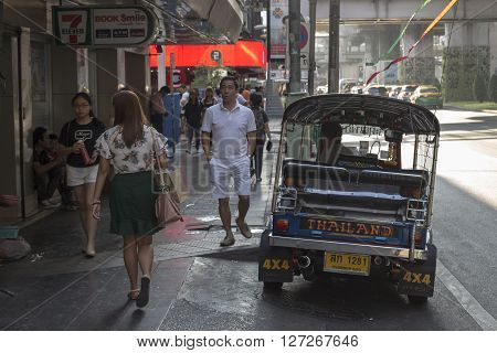 BANGKOK THAILAND - APR 10 : tuktuk wait for passenger near Lido Multiplex of Siam Square on april 10 2016 thailand. Tuktuk is name of three wheeled taxi car in thailand