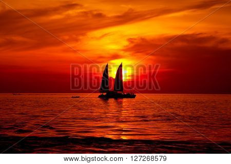 ship or boat on the sea in sunrise or sunset period with red color filter