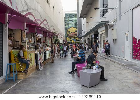 BANGKOK THAILAND - APR 10 : life of people at food stall alley at side of Digital Gateway in siam square on april 10 2016 thailand. Siam square is famous shopping place of Bangkok