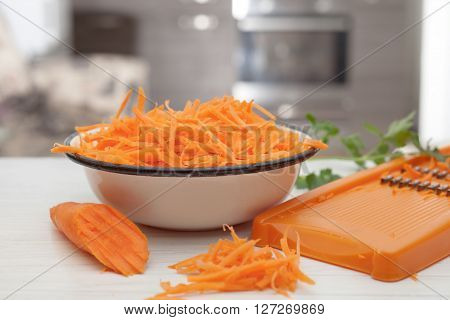 half carrot grated carrots and grater,food ingredients