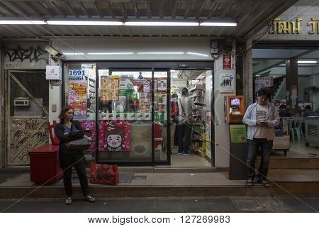 BANGKOK THAILAND - JAN 25 : unidentified people at outside of Seven-Eleven store near National Stadium on january 25 2016