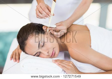 Young woman receiving spa treatment from female masseur