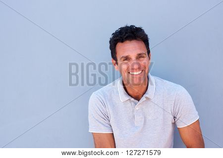 Close Up Portrait Of A Handsome Older Man Smiling