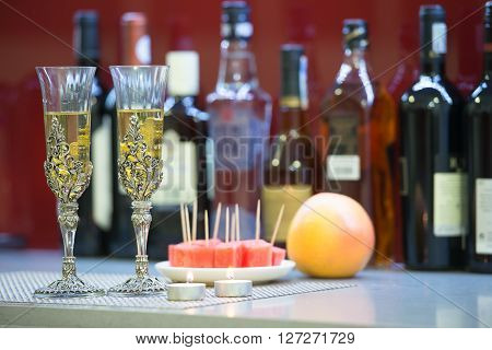 Glasses inlaid with silver and wine on table with watermelon