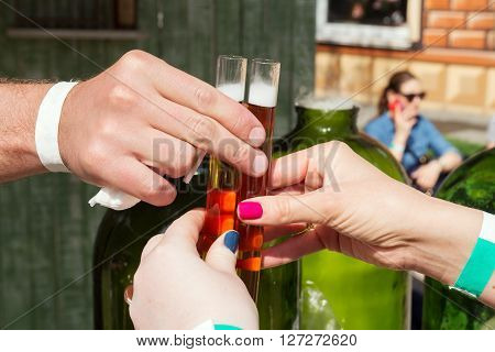 hands with alcohol tincture in test-tube liquor