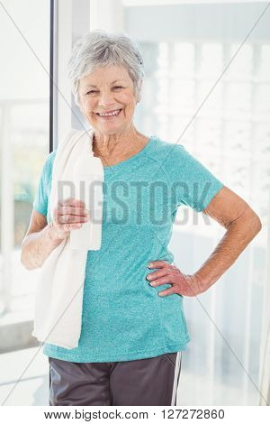 Portrait of happy woman holding towel at home