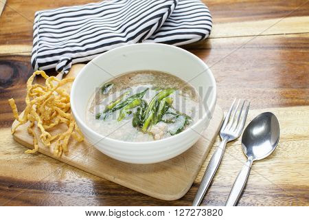 Fried noodle in Gravy on wooden background