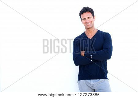 Handsome Rugged Man Smiling Against White Background