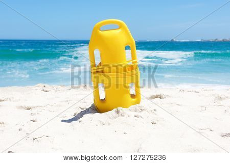 Life Buoy In Sand At Beach