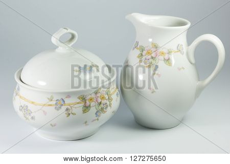 Sugar Bowl And Milk Jug With Flowers On White Background