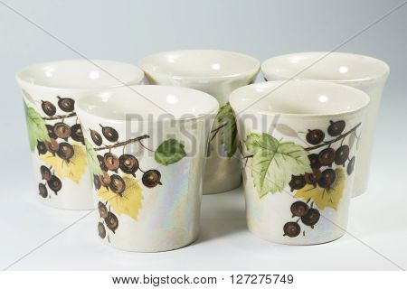 Five Painted Porcelain Shot Glasses On White Background