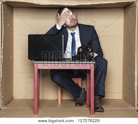 Businessman Wipes His Forehead