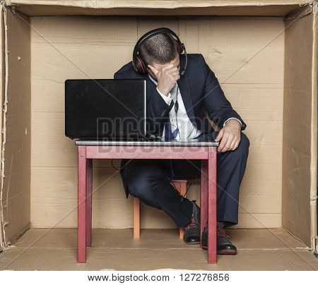 Depressed Employee Sitting In The Office