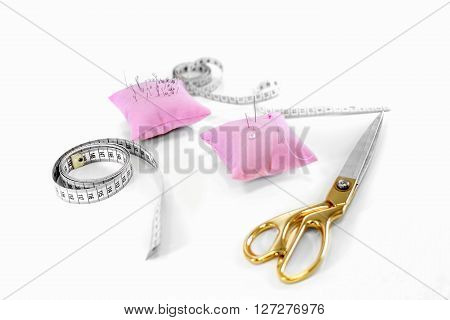 Set of sewing scissors measuring tape fabric and pins for sewing and needlework . sewing kit