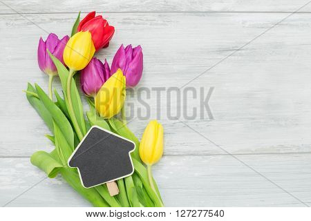 Beautiful tulips with home shaped clip for Mothers day