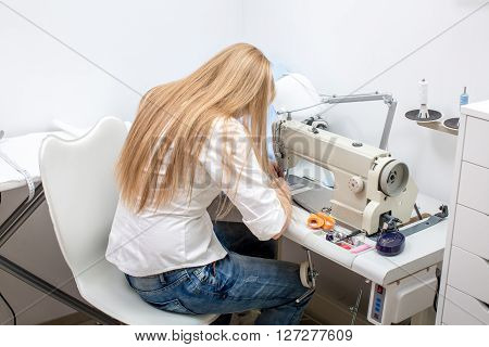Girl Seamstress Sew On The Sewing Machine