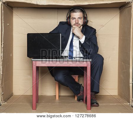 Thoughtful Businessman Sitting In The Office