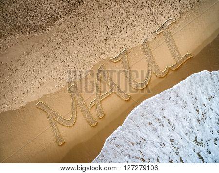 Maui written on the beach