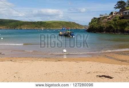 SALCOMBE, DEVON, ENGLAND-MAY  31ST  2015: Sunny summer weekend  weather saw visitors using the sea tractor and ferry at South Sands, Salcombe, Devon on Sunday 31st May 2015