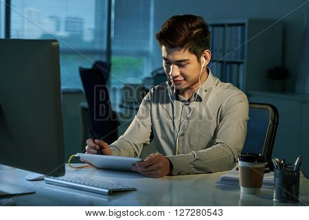 Young businessman using stylus and digital tablet when working in office