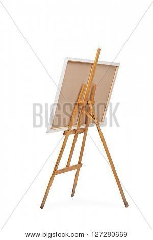 Rear view vertical shot of a wooden easel with a canvas on it isolated on white background