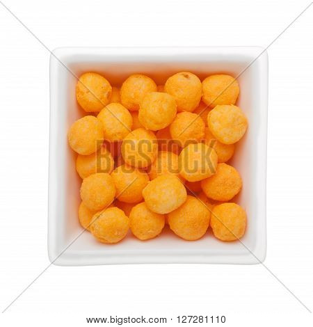 Cheese flavor corn snack in a square bowl isolated on white background