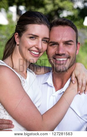 Close-up portrait of smiling happy young couple