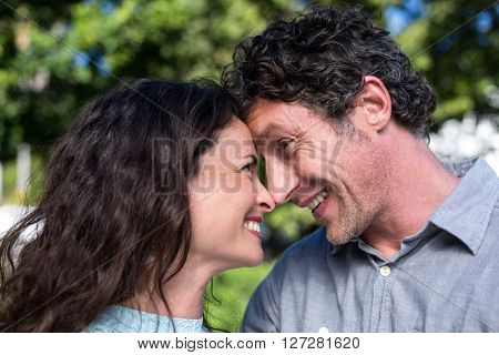Close-up of smiling happy couple in park