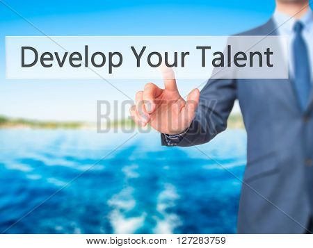 Develop Your Talent - Businessman Hand Pressing Button On Touch Screen Interface.