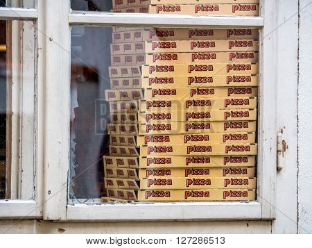 boxes for pizza in a pizzeria. street sales in the