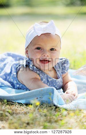 Little beautiful girl lying on the grass