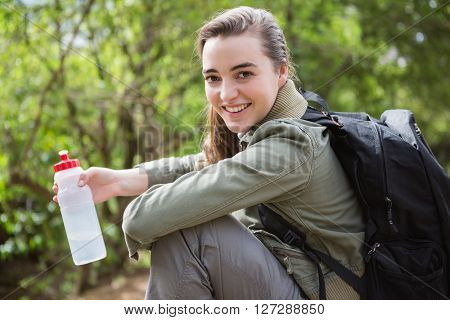 Woman holding water bottle in the countryside