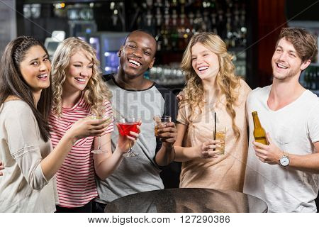 Group of friends having a drink in a night club
