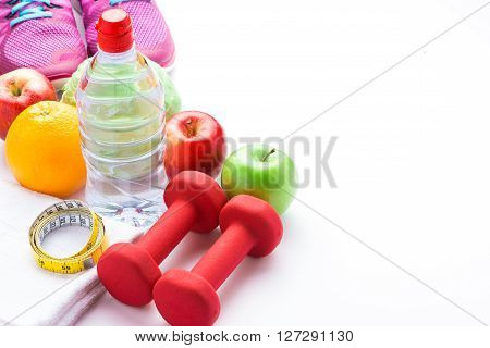 Sport shoes sneakers, water, measuring tape and apples on white background. Top view sport equipment. Healthy life and healthy food concept