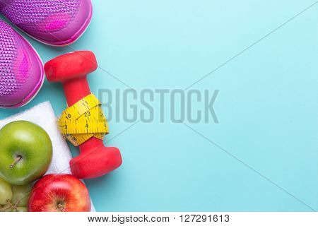 Sport shoes,measuring tape and apples on white background. Healthy life and healthy food concept
