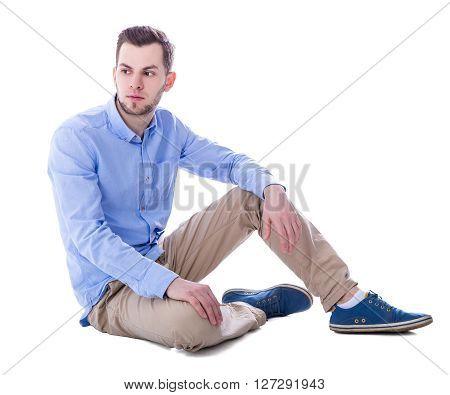 Portrait Of Sad Man Thinking About Something Sitting Isolated On White